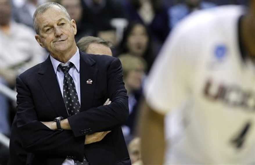 Connecticut head coach Jim Calhoun watches the action during the first half of the West Regional third-round NCAA tournament college basketball game against Cincinnati, Saturday, March 19, 2011, at the Verizon Center in Washington.   (AP Photo/Alex Brandon)