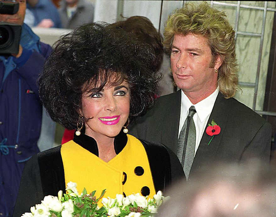 In this Nov. 5, 1991 file photo, Elizabeth Taylor arrives at a restaurant accompanied by her husband Larry Fortenski in London. Publicist Sally Morrison says the actress died Wednesday, March 23, 2011 in Los Angeles of congestive heart failure at age 79. (AP Photo/Gill Allen, File)