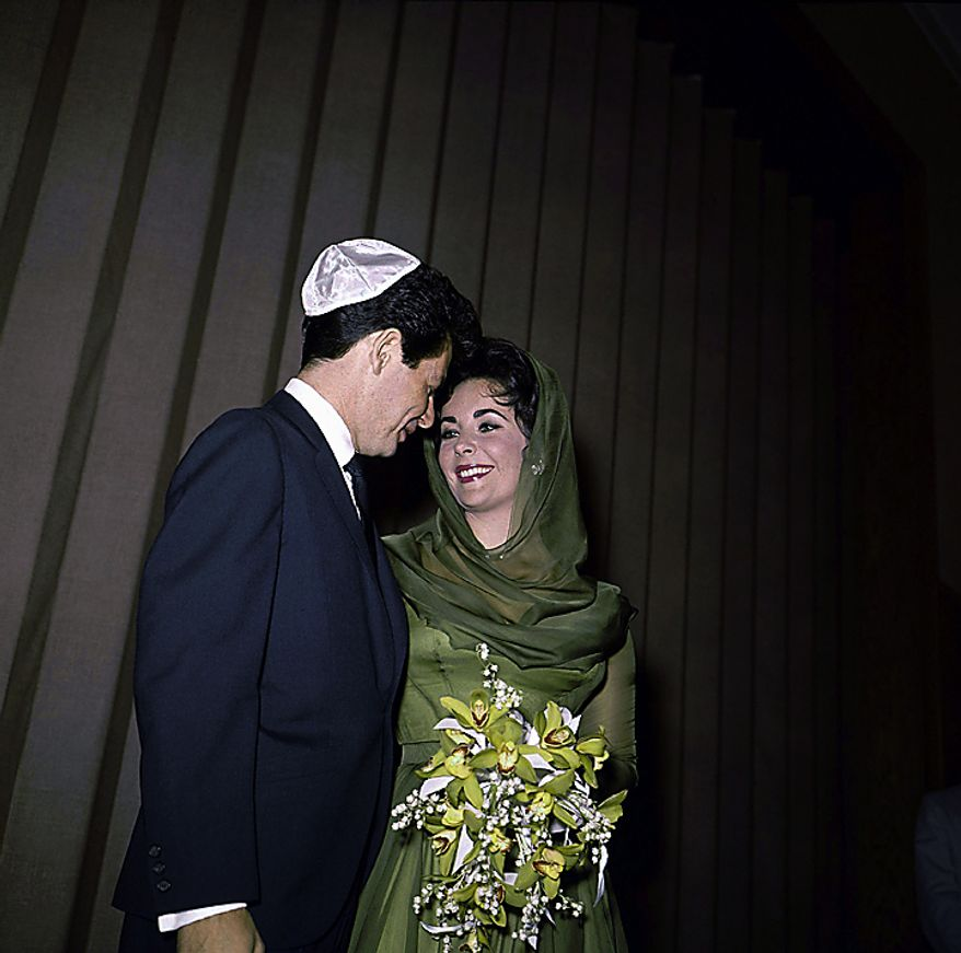In this May 12, 1959 file photo, Eddie Fisher stands with his wife Elizabeth Taylor after their marriage in Las Vegas. Publicist Sally Morrison says the actress died Wednesday, March 23, 2011 in Los Angeles of congestive heart failure at age 79. (AP Photo/File)