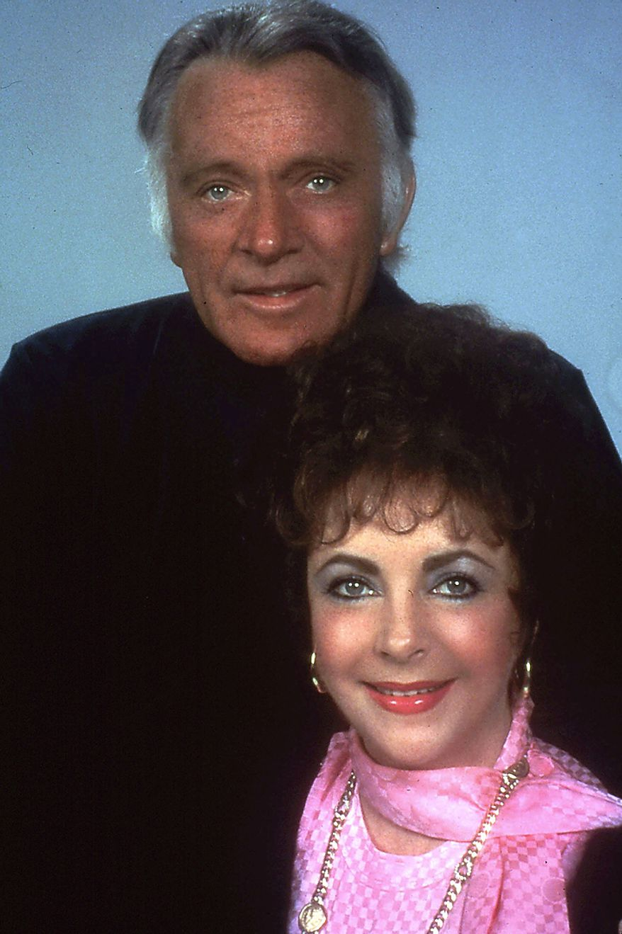 """This 1983 file photo shows actress Elizabeth Taylor and actor Richard Burton, one of Taylor's former husbands, posing during a rehearsal for the Broadway revival in New York of Noel Coward's """"Private Lives."""" Publicist Sally Morrison says Taylor died Wednesday, March 23, 2011 in Los Angeles of congestive heart failure at age 79. (AP Photo/File)"""