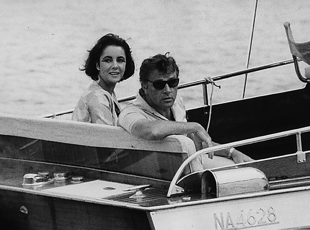 "In this June 15, 1962 file photo, Richard Burton and Elizabeth Taylor arrive in a motor launch at the small town Porto d'Ischia, on the isle of Ischia in the Gulf of Naples, Italy for the shooting of some scenes of ""Cleopatra"". Publicist Sally Morrison says Taylor died Wednesday, March 23, 2011 in Los Angeles of congestive heart failure at age 79. (AP Photo/Girolamo, File)"