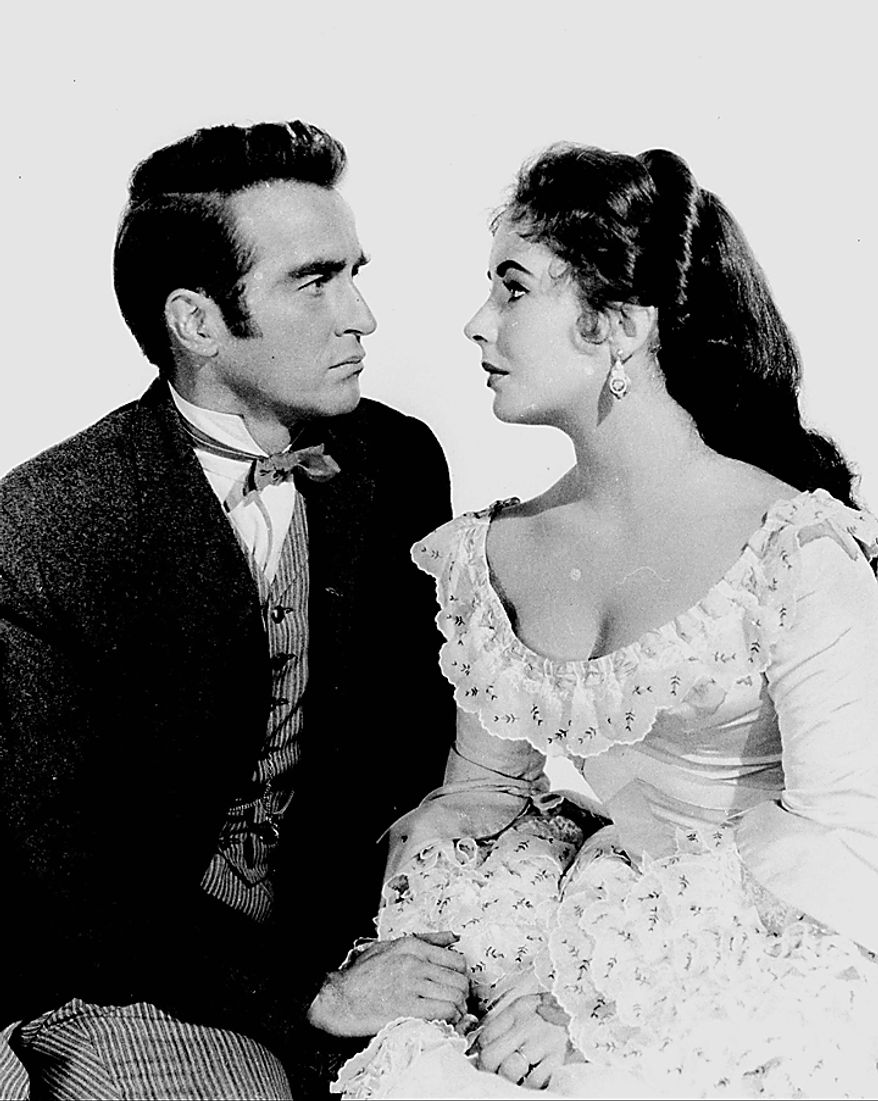 "In this 1957 file photo, Elizabeth Taylor poses with Montgomery Clift for the film ""Raintree County."" Publicist Sally Morrison says Taylor died Wednesday, March 23, 2011 in Los Angeles of congestive heart failure at age 79. (AP Photo/File)"