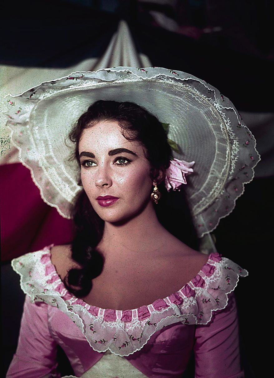 """In this 1957 file photo, actress Elizabeth Taylor is shown in costume for her character in the film """"Raintree County."""" Publicist Sally Morrison says the actress died Wednesday, March 23, 2011 in Los Angeles of congestive heart failure at age 79. (AP Photo/File)"""