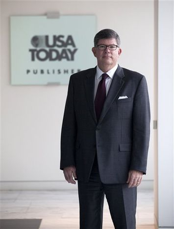 In this Nov. 23, 2010 photo, USA Today publisher Dave Hunke  is seen at the headquarters of USA Today, in McLean, Va.   (AP Photo/Evan Vucci)
