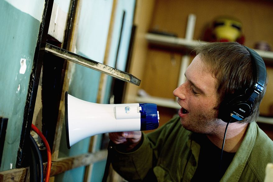 Mr. Somerville uses a megaphone to get just the right sound. (Barbara L. Salisbury/The Washington Times)