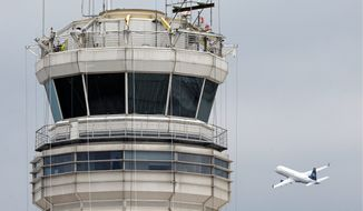 ** FILE ** A passenger jet takes off near the FAA control tower at Ronald Reagan Washington National Airport in March 2011. (AP Photo)