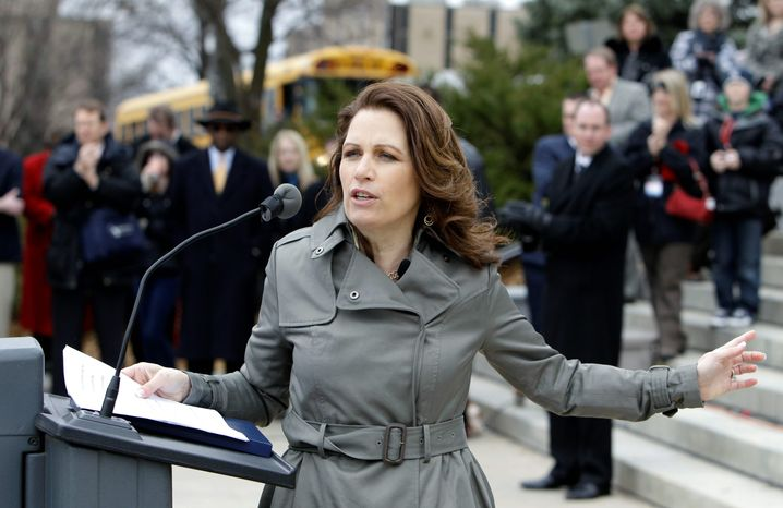 U.S. Rep. Michele Bachmann, Minnesota Republican, speaks at a rally by home-school backers in Des Moines, Iowa. More than 1,000 advocates were cheered on by her and two other potential GOP presidential candidates who joined their cause. (Associated Press)