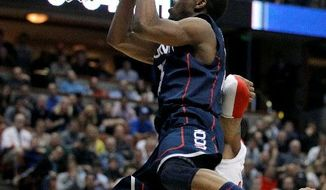 Connecticut's Kemba Walker drives against San Diego State in the second half of a West Regional semifinal in the NCAA tournament Thursday in Anaheim, Calif. UConn won 74-67. (Associated Press)