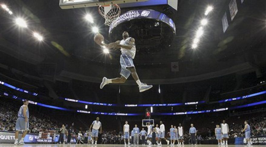 North Carolina's Dexter Strickland dunks during practice for an East regional semifinal game in the NCAA college basketball tournament, Thursday, March 24, 2011, in Newark, N.J. North Carolina will play Marquette on Friday. (AP Photo/Julio Cortez)