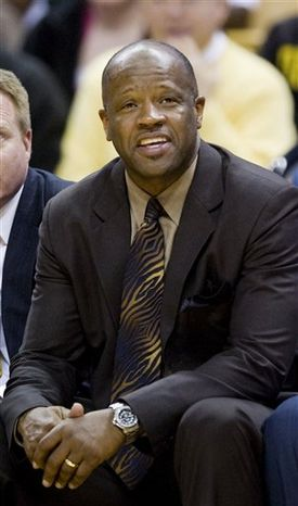 FILE - In this Dec. 18, 2010, file photo, Missouri head coach Mike Anderson watches his team perform during the second half of an NCAA college basketball game against Central Arkansas in Columbia, Mo. Anderson is returning to Arkansas to become the Razorbacks' basketball coach. The school confirmed the move on Wednesday night, March 23, 2011. (AP Photo/L.G. Patterson,File)