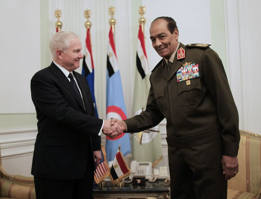 U.S. Defense Secretary Robert M. Gates (left) meets with Field Marshal Mohamed Hussein Tantawi, head of the Egyptian Armed Forces Supreme Council, in Cairo on Thursday, March 24, 2011. (AP Photo/Charles Dharapak, Pool)