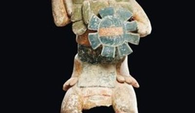 In this photo provided by Paris-based Binoche Et Giquello auction house gallery on Wednesday March 23, 2011 is seen a Mayan-style statue. The Mexican government on Wednesday said a Mayan-style statue that brought a record $4 million (2.9 million euros) at auction this week is a fake. Auctioneers vow it is genuine and claim Mexico wants to quash legal sales of pre-Hispanic artifacts. (AP Photo/Binoche Et Giquello) NO SALES