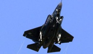 POWERED DOWN: The alternate engine for the F-35 jet has been halted by a 90-day stop-work order. (Associated Press)