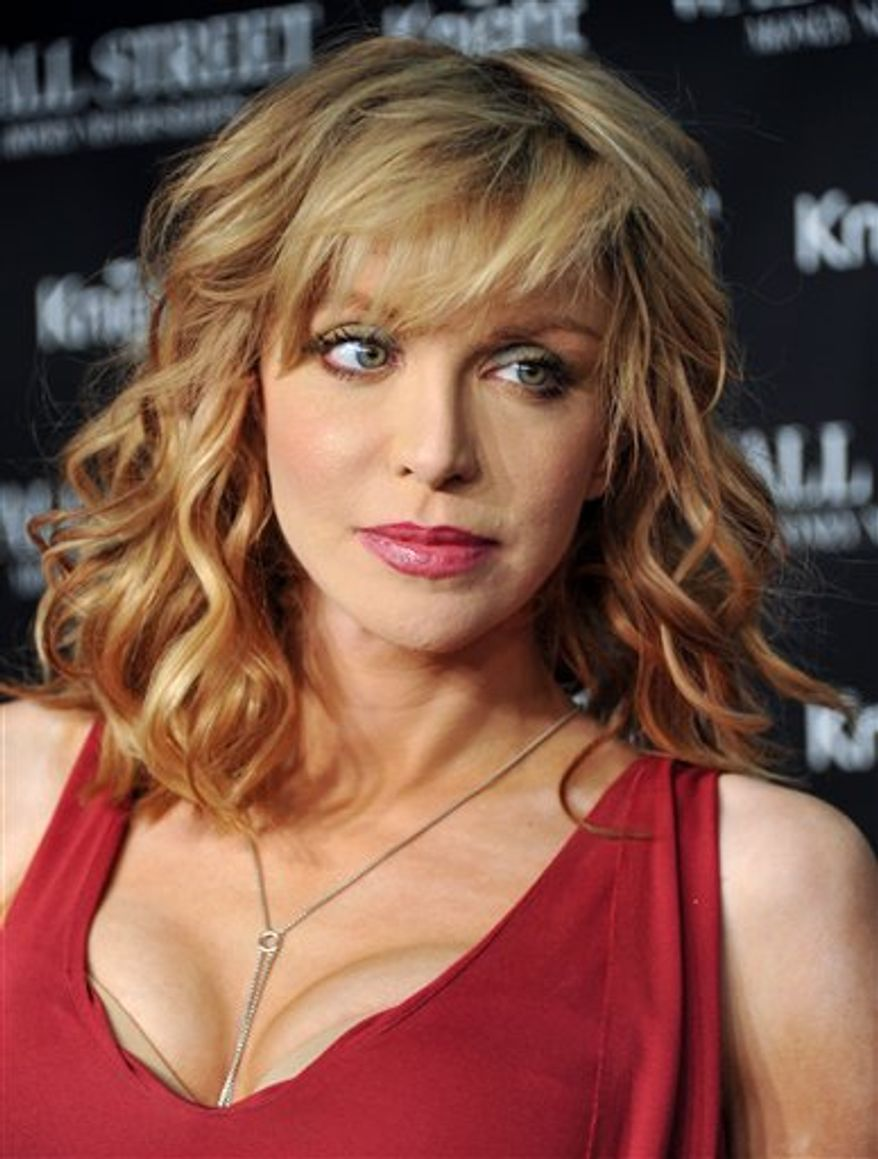FILE - In this Sept. 20, 2010 file photo, musician Courtney Love attends the premiere of 'Wall Street: Money Never Sleeps' at the Ziegfeld Theatre in New York. (AP Photo/Evan Agostini, File)