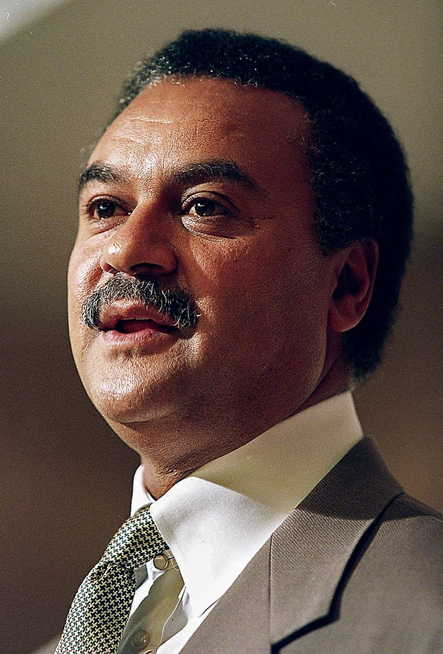 ** FILE ** Commerce Secretary Ron Brown is shown in this May 1995 file photo. The special prosecutor investigating Brown is reviewing activities with an Oklahoma gas company that include a $160,000 payment to Brown's son and trips for a top Commerce aide, according to interviews and documents. (AP Photo/File, J. Scott Applewhite)