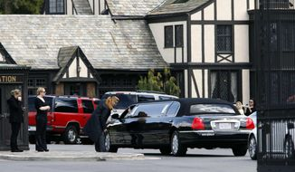 A stretch limousine arrives at Forest Lawn Cemetery for funeral services for Elizabeth Taylor on Thursday, March 24, 2011, in Glendale, Calif. Taylor, 79, died early Wednesday of congestive heart failure while surrounded by her four children at Los Angeles' Cedars-Sinai Medical Center, where she had been hospitalized for about six weeks. (AP Photo/Nick Ut)