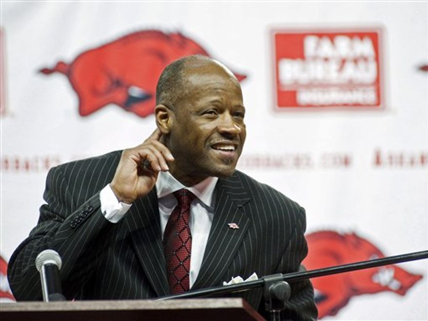 Arkansas head basketball coach Mike Anderson calls the hogs during a news conference to announce his hiring on Saturday, March 26, 2011, in Fayetteville, Ark. Anderson, who was assistant coach under Nolan Richardson, replaced John Pelphrey. (AP Photo/Beth Hall)