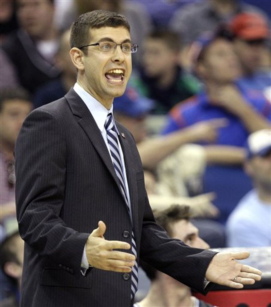 Butler head coach Brad Stevens calls out to his team during the first half of the NCAA Southeast regional college basketball semifinal game against Wisconsin Thursday, March 24, 2011, in New Orleans. (AP Photo/Patrick Semansky)