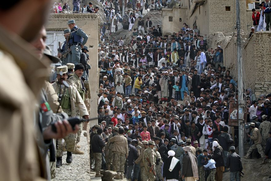** FILE ** Afghan police stop people outside the Sakhi shrine during Nawroz, a new year ceremony, in Kabul, Afghanistan, on Monday, March 21, 2011. (AP Photo/Musadeq Sadeq)