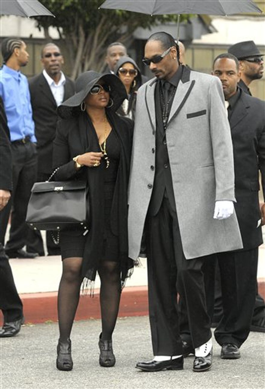 Rapper Game arrives at the memorial service for the late rapper Nate Dogg at the Queen Mary Dome in Long Beach, Calif. on Saturday, March 26, 2011. Nate Dogg, whose real name is Nathaniel Dwayne Hale, died on March 15th. (AP Photo/Dan Steinberg)