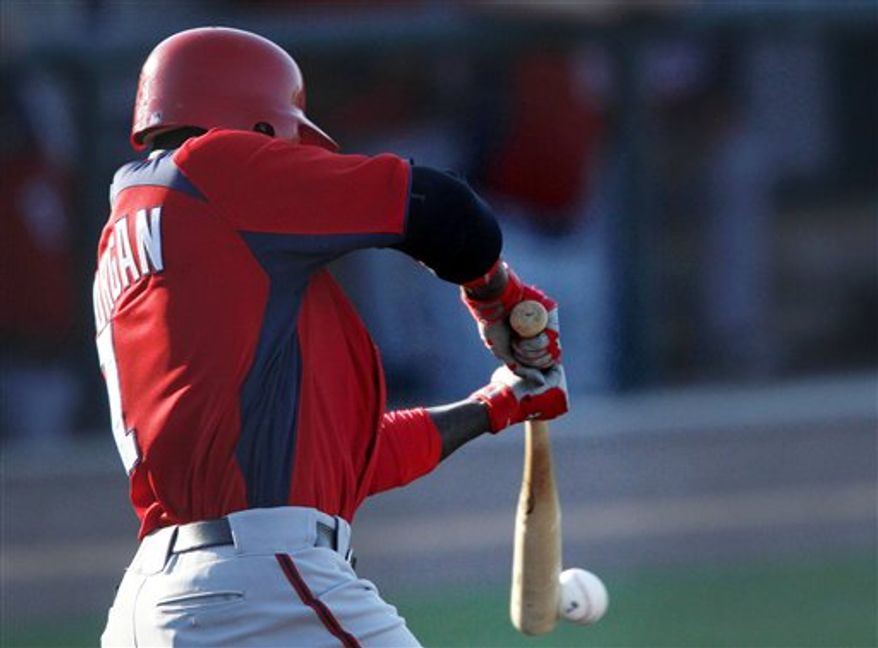 Washington Nationals' Nyjer Morgan hits a single in the first inning of spring training baseball game against the Detroit Tigers on Thursday, March 24, 2011 in Lakeland, Fla. (AP Photo/David Goldman)
