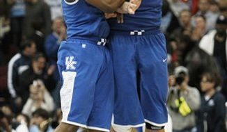 Kentucky's Josh Harrellson, right, and Stacey Poole Jr. celebrate during the second half against North Carolina in the final of the NCAA men's college basketball tournament East regional, Sunday, March 27, 2011, in Newark, N.J. Kentucky won 76-69. (AP Photo/Frank Franklin II)