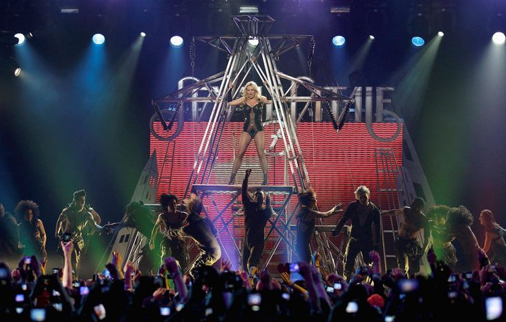 """ASSOCIATED PRESS Britney Spears, performing at the Bill Graham Civic Auditorium in San Francisco, fills her latest album """"Femme Fatale"""" with music that celebrates her hedonistic past, crooning risque lyrics and double entendres over a backdrop of thumping  dance-floor beats."""