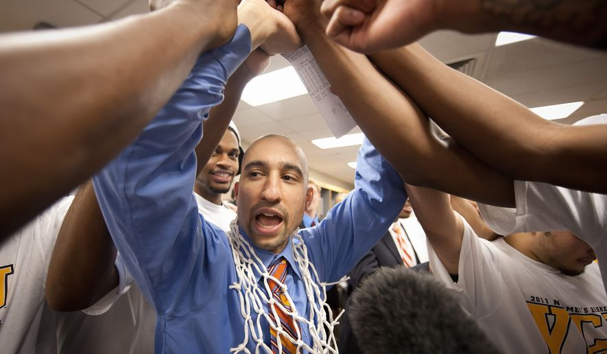 ASSOCIATED PRESS VCU head coach Shaka Smart celebrates with his team after winning the Southwest regional final game against Kansas in the NCAA college basketball tournament on Sunday in San Antonio. VCU won 71-61 to advance to the Final Four. VCU's offense has scored 70 or more points in its last four games.
