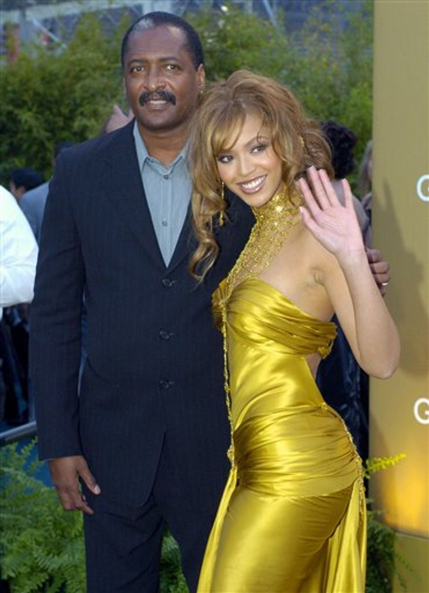 FILE - In this Feb. 8, 2004 file photo, singer Beyonce Knowles arrives at the 46th Annual Grammy Awards with her father and manager Mathew Knowles in Los Angeles. (AP Photo/Mark J. Terrill, file)