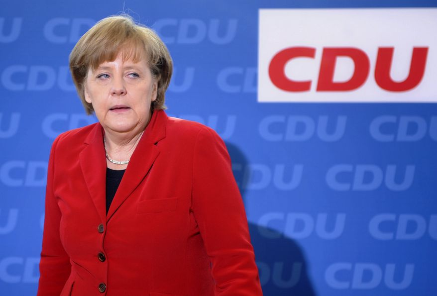 German Chancellor Angela Merkel, who also is chairwoman of the conservative Christian Democratic Union party, arrives for the party's weekly executive committee meeting in Berlin on Monday, March 28, 2011. The CDU  suffered a major defeat Sunday in Baden-Wuerttemberg state elections after almost six decades in power there. (AP Photo/dapd/Berthold Stadler)