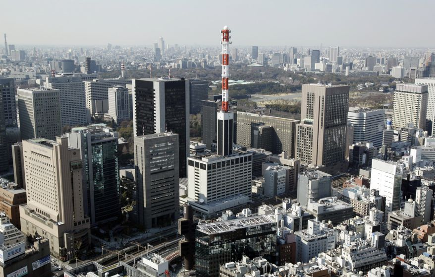 The headquarters building of the Tokyo Electric Power Co., also known as Tepco, at the base of the communications tower in the middle, is pictured in Tokyo on Monday, March 28, 2011. The company, which runs the Fukushima Dai-ichi nuclear power plant at the center of the country's nuclear crisis, has issued a series of botched radiation readings from the plant in recent days. (AP Photo/Greg Baker)