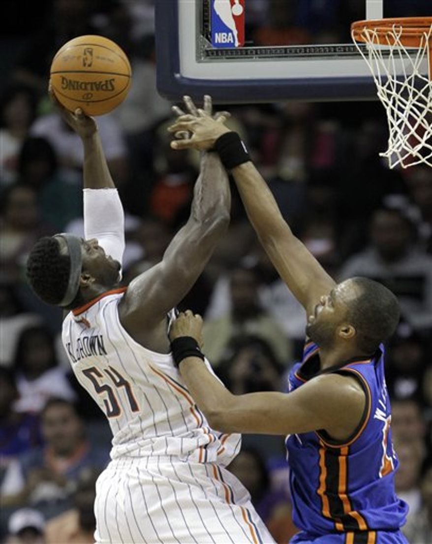 Charlotte Bobcats' Kwame Brown (54) shots over New York Knicks' Shelden Williams (13) in the second half of the Bobcats' 114-106 win in an NBA basketball game in Charlotte, N.C., Saturday, March 26, 2011. (AP Photo/Chuck Burton)