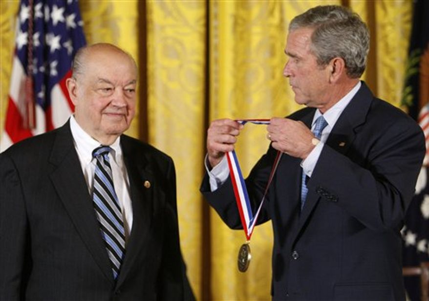 FILE -- In a Sept. 29, 2008 file photo then President Bush presents Paul Baran a 2007 National Medal of Technology and Innovation in the East Room of the White House in Washington.  Baran whose work with packaging data in the 1960s has been credited with playing a key role in the later development of the Internet, died Saturday March 26, 2011 his son told The Associated Press. (AP Photo/Charles Dharapak/file)