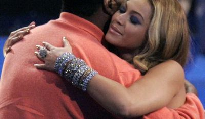 """FILE - In this Nov. 18, 2007 file photo, singer Beyonce Knowles hugs her father Mathew Knowles after being named the recipient of the International Star of the Year Award at the American Music Awards in Los Angeles. In a statement released by her publicist on Monday, March 28, 2011, Beyonce announced that she and her father have parted ways """"on a business level.""""  Mathew Knowles has managed his daughter since she debuted as a teen in the multiplatinum-selling group Destiny's Child in the late 1990s and throughout her superstar career as a solo artist. (AP Photo/Mark J. Terrill, file)"""