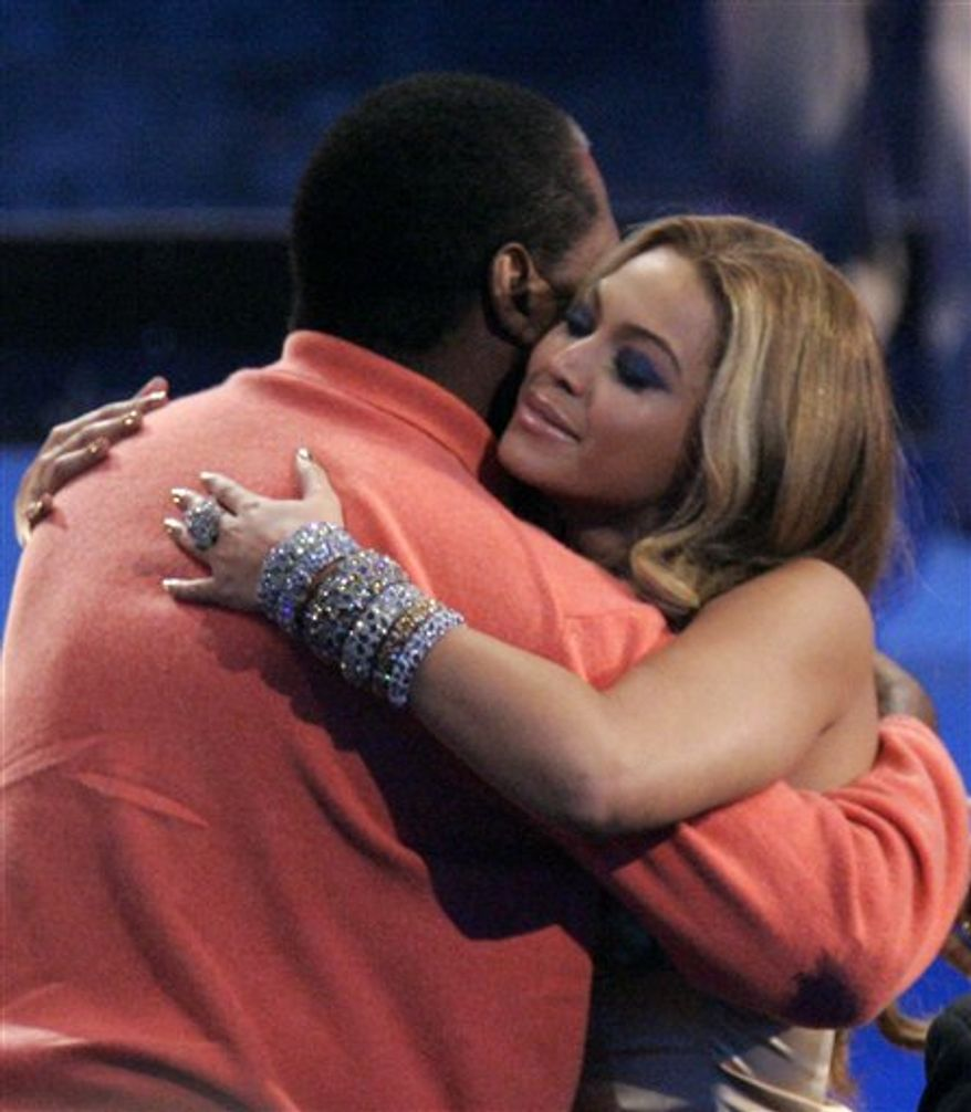"FILE - In this Nov. 18, 2007 file photo, singer Beyonce Knowles hugs her father Mathew Knowles after being named the recipient of the International Star of the Year Award at the American Music Awards in Los Angeles. In a statement released by her publicist on Monday, March 28, 2011, Beyonce announced that she and her father have parted ways ""on a business level.""  Mathew Knowles has managed his daughter since she debuted as a teen in the multiplatinum-selling group Destiny's Child in the late 1990s and throughout her superstar career as a solo artist. (AP Photo/Mark J. Terrill, file)"