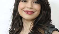 """FILE - In this Feb. 27, 2011 file photo, actress and singer Miranda Cosgrove arrives at the 2011 Elton John Academy Award viewing party in West Hollywood, Calif. Cosgrove of Nickelodeon's """"ICarly"""" is participating in the cable network's Public Service Announcement campaign, Monday, March 28, 2011, aimed at addressing cyberbullying. (AP Photo/Dan Steinberg, file)"""