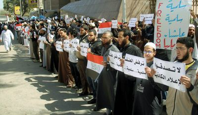 "Ultraconservative Muslims from the Salafi movement staged a protest in Cairo on Tuesday, accusing the local Christian church of abducting a Muslim convert. The protest came amid signs of increasing assertiveness by the fundamentalist movement. The signs in Arabic read: ""dont believe false media"" and ""we reject the aggression."" (Associated Press)"