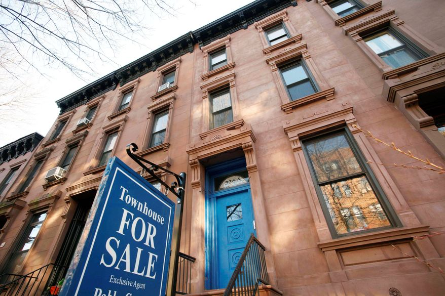 A town house is for sale in Brooklyn, N.Y. Housing prices fell in 19 of 20 large cities and 0.22 percent overall in January, according to the S&P/Case-Shiller index released Tuesday. Washington was the only city in which prices rose. Prices have fallen 3 percent in the past year. (Associated Press)