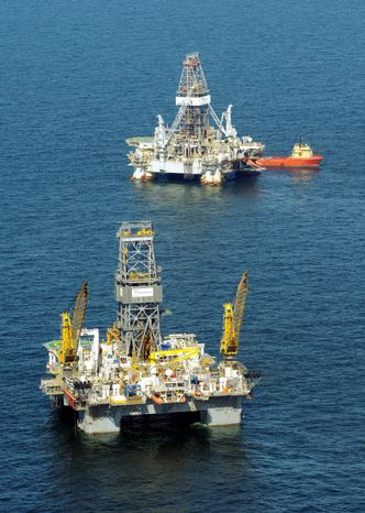 The Transocean Development Driller II (top) and III are seen here in the Gulf of Mexico near the Louisiana coast in August. (Associated Press)