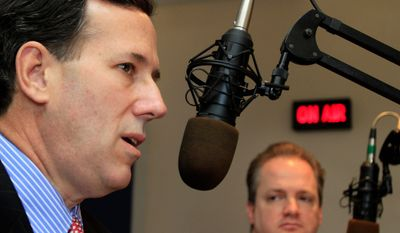 Former Sen. Rick Santorum of Pennsylvania, a possible 2012 Republican presidential candidate, answers a question Tuesday  on WEZS radio in Laconia, N.H., as former Laconia City Council member Tom Brown looks on. (Associated Press)