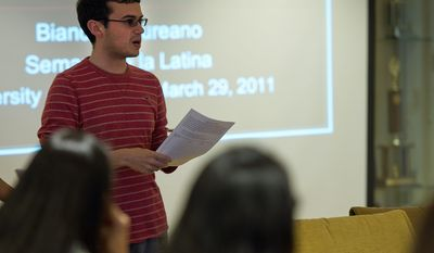 Speaking at a Semana de la Latina event Tuesday, University of Maryland senior Jacob Crider asks for support of a bill that would grant in-state tuition to many Maryland illegal immigrants. (Barbara L. Salisbury/The Washington Times)