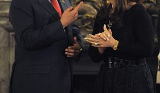 Venezuela's President Hugo Chavez, left, and Argentina's President Cristina Fernandez speak during a meeting at the government house in Buenos Aires, Tuesday, March 29, 2011. Chavez is on a one-day official visit to Argentina. (AP Photo/Jorge Araujo)