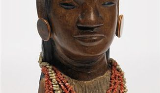 "This undated photo provided by Sotheby's shows a rare wooden bust of a Tahitian girl wearing large earrings and a coral and shell necklace, carved by Paul Gauguin in the 1890s during his first visit to the South Pacific islands. ""Jeune tahitienne"" will be sold at Sotheby's on May 3, 2011, after it is shown at the auction house's galleries in Hong Kong on April 1-5 and London on April 14-18. It will go on view in New York on April 29. (AP Photo/Sotheby's) NO SALES"