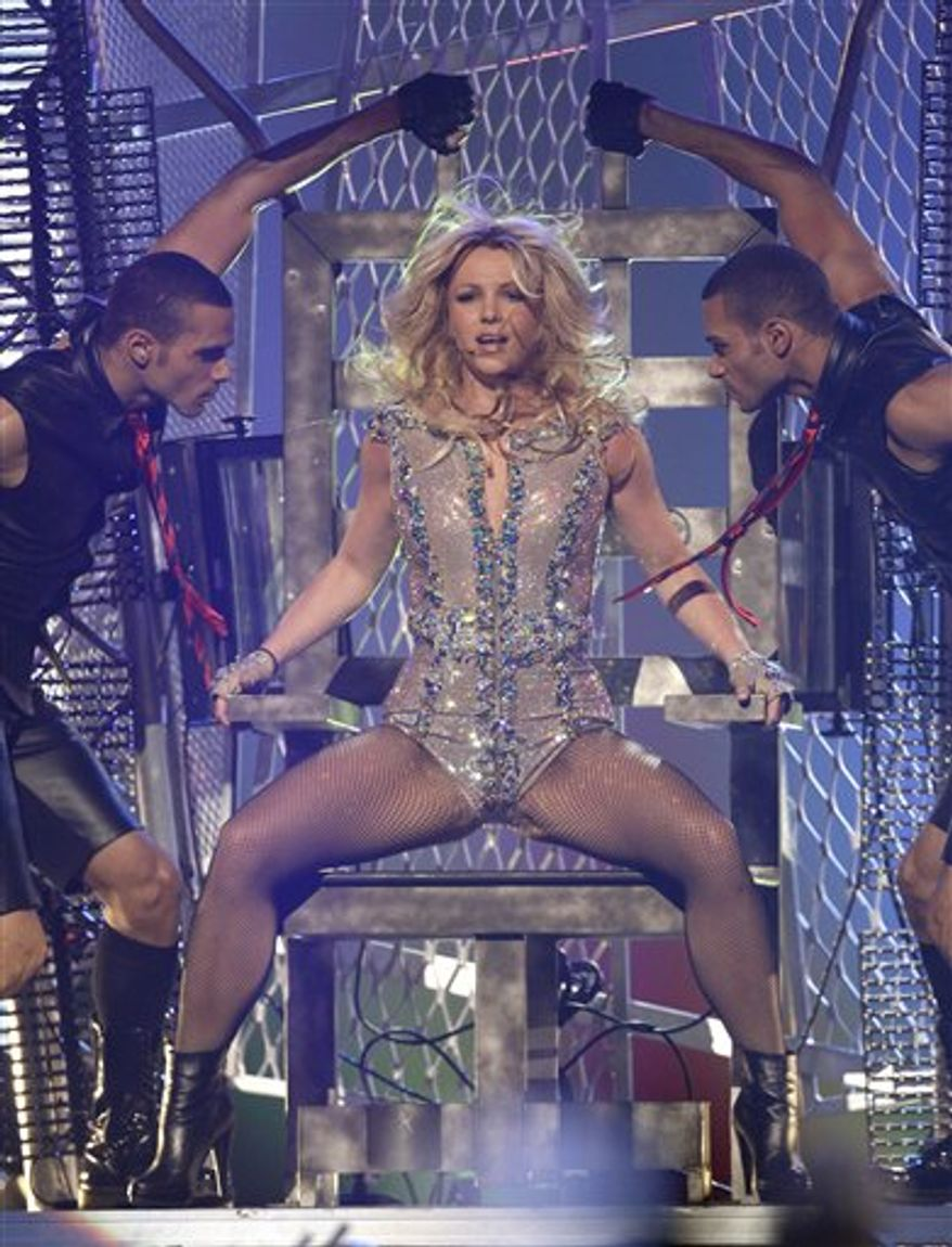 "Singer Britney Spears performs on ABC's ""Good Morning America"" show at the Bill Graham Civic Auditorium in San Francisco on Sunday, March 27, 2011. (AP Photo/Tony Avelar)"