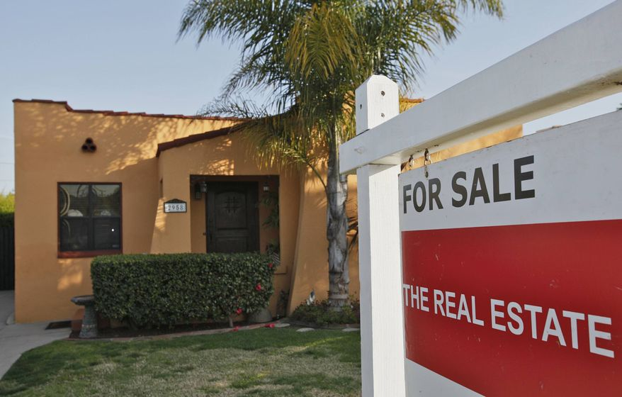 In this photo taken on Tuesday, March 22, 2011, a single family home is offered for sale in Los Angeles. Home prices are falling in most major U.S. cities, and now the average price in four of them are at the lowest point in 11 years. (AP Photo/Damian Dovarganes)