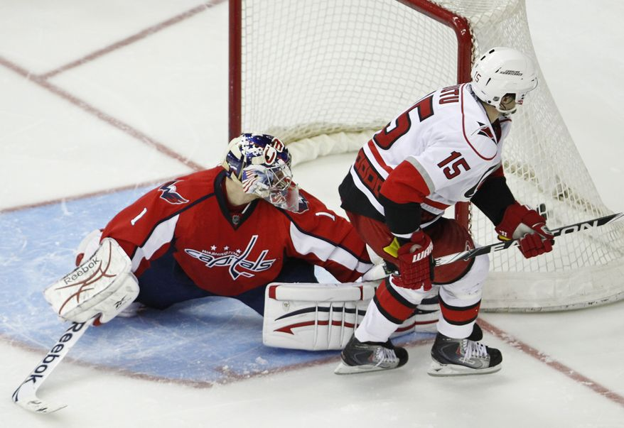 Carolina Hurricanes' Tuomo Ruutu (15), of Finland, scores a goal against Washington Capitals goalie Semyon Vallamov (1) during a shootout of an NHL hockey game in Washington, Tuesday, March 29, 2011. Hurricanes won 3-2 in a shootout. (AP Photo/Manuel Balce Ceneta)