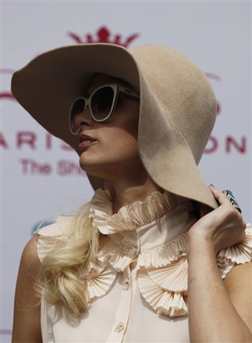 Paris Hilton during her autograph signing session at a Sears in the Perisur Mall of Mexico City, Mexico, Tuesday March 29, 2011. Hilton is in Mexico to promote her new shoe line.  (AP Photo/Eduardo Verdugo)