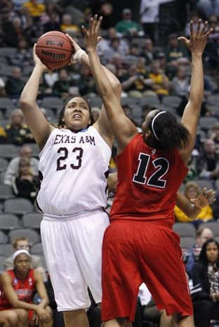 Texas A&M's Danielle Adams (23) shoots against Georgia's Jasmine Hassell (12) during the first half of an NCAA women's college basketball tournament regional semifinal in Dallas, Sunday, March 27, 2011. (AP Photo/LM Otero)