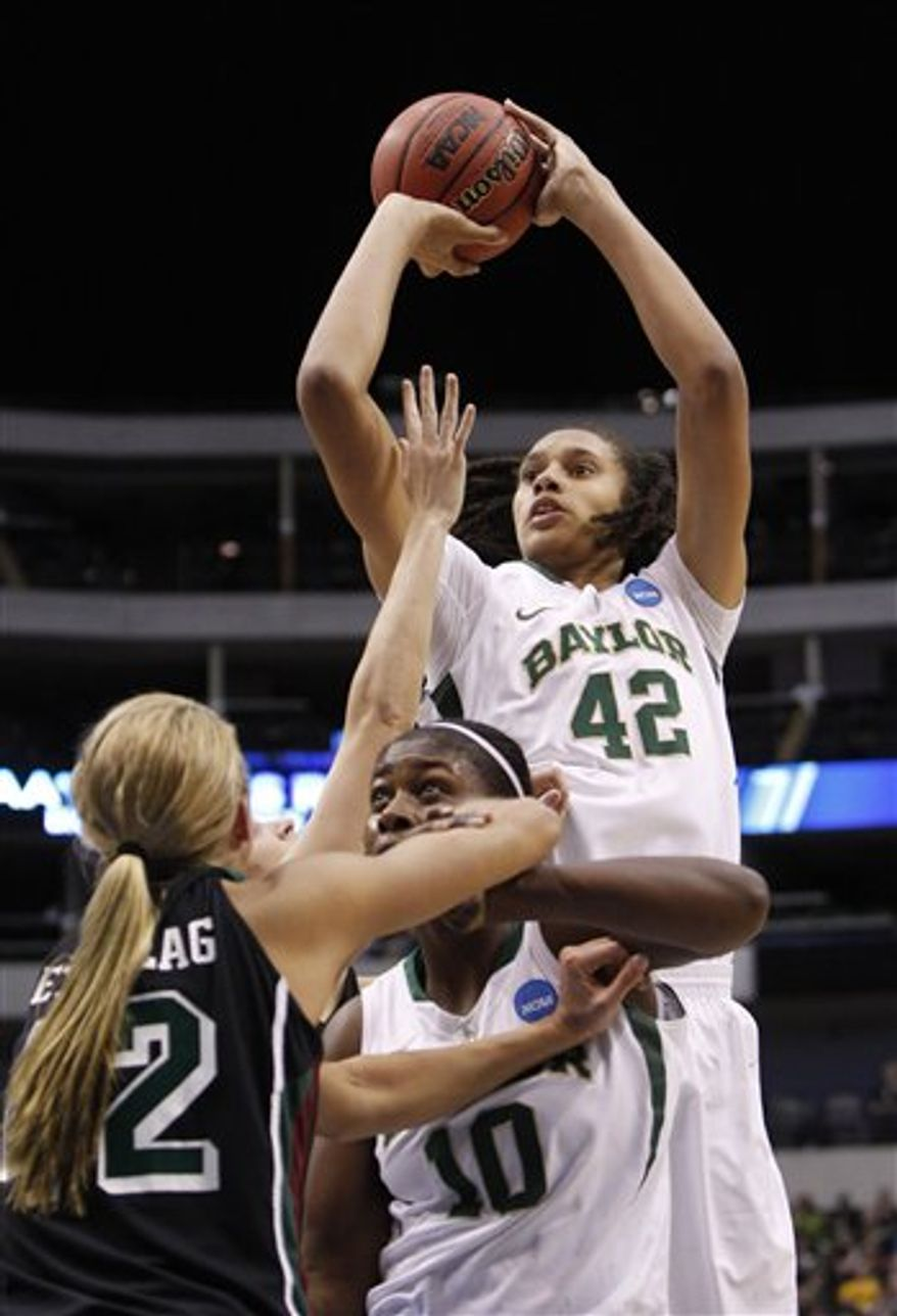 Baylor's Brittney Griner (42) shoots as teammate Destiny Williams screens Wisconsin-Green Bay's Kayla Tetschlag (42) during the first half of an NCAA women's college basketball tournament regional semifinal, Sunday, March 27, 2011, in Dallas. (AP Photo/LM Otero)