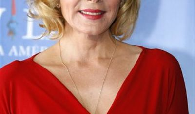 """FILE - In this Sept. 11, 2010 file photo, U.S. actress Kim Cattrall from the film """" Meet Monica Velour"""" poses for photographers at the 36th American Film Festival in Deauville, Normandy, France. Cattrall plays a aging adult film star and a single mother in the film. (AP Photo/Michel Spingler, file)"""